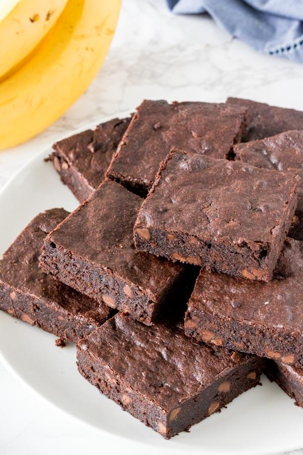 A plate of chewy banana brownies with chocolate chips