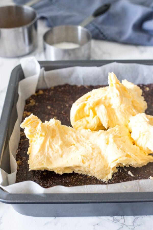 Making Nanaimo bars - adding the vanilla custard middle flavor to Nanaimo bars.