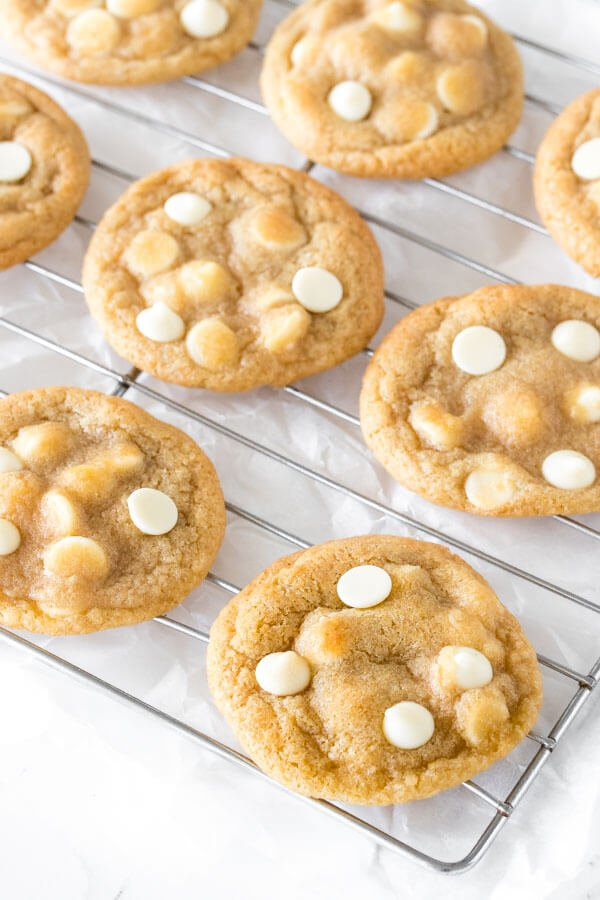 White chocolate chip cookies on a cooling rack.