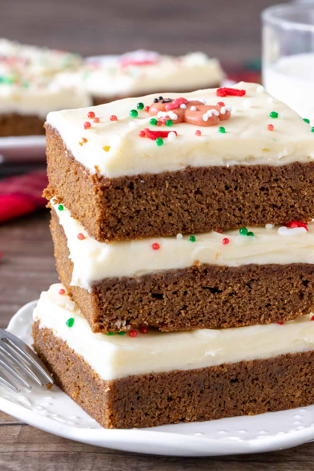 Stack of 3 cookie bars topped with frosting and sprinkles