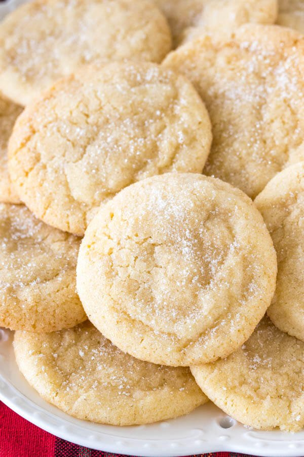 A plate of chewy sugar cookies rolled in sugar.