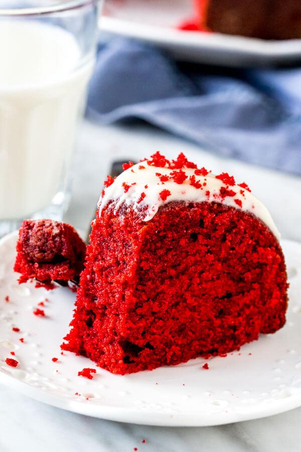 Slice of red velvet bundt cake with a bite taken out of it.
