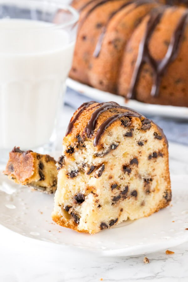 Slice of chocolate chip pound cake on a plate with a bite taken out of it with a fork.
