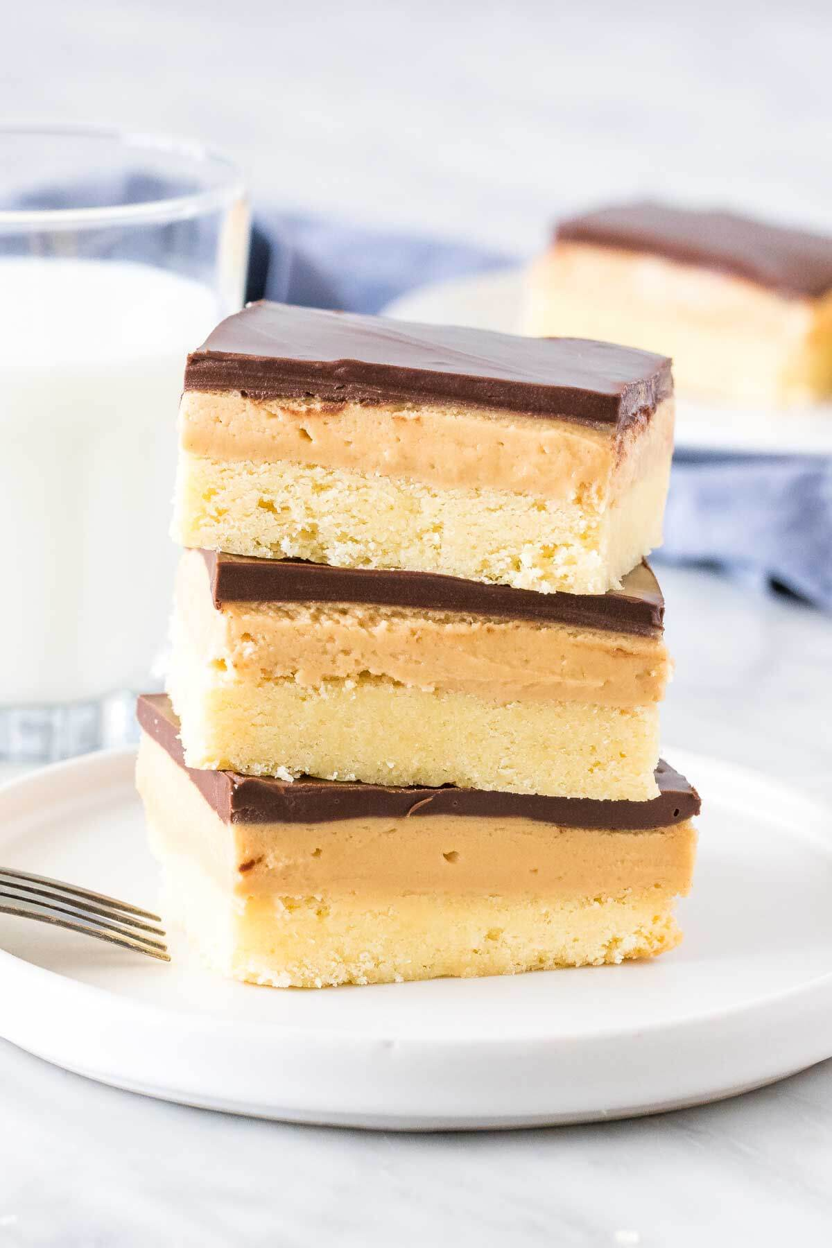 Stack of 3 peanut butter shortbread bars with a glass of milk.