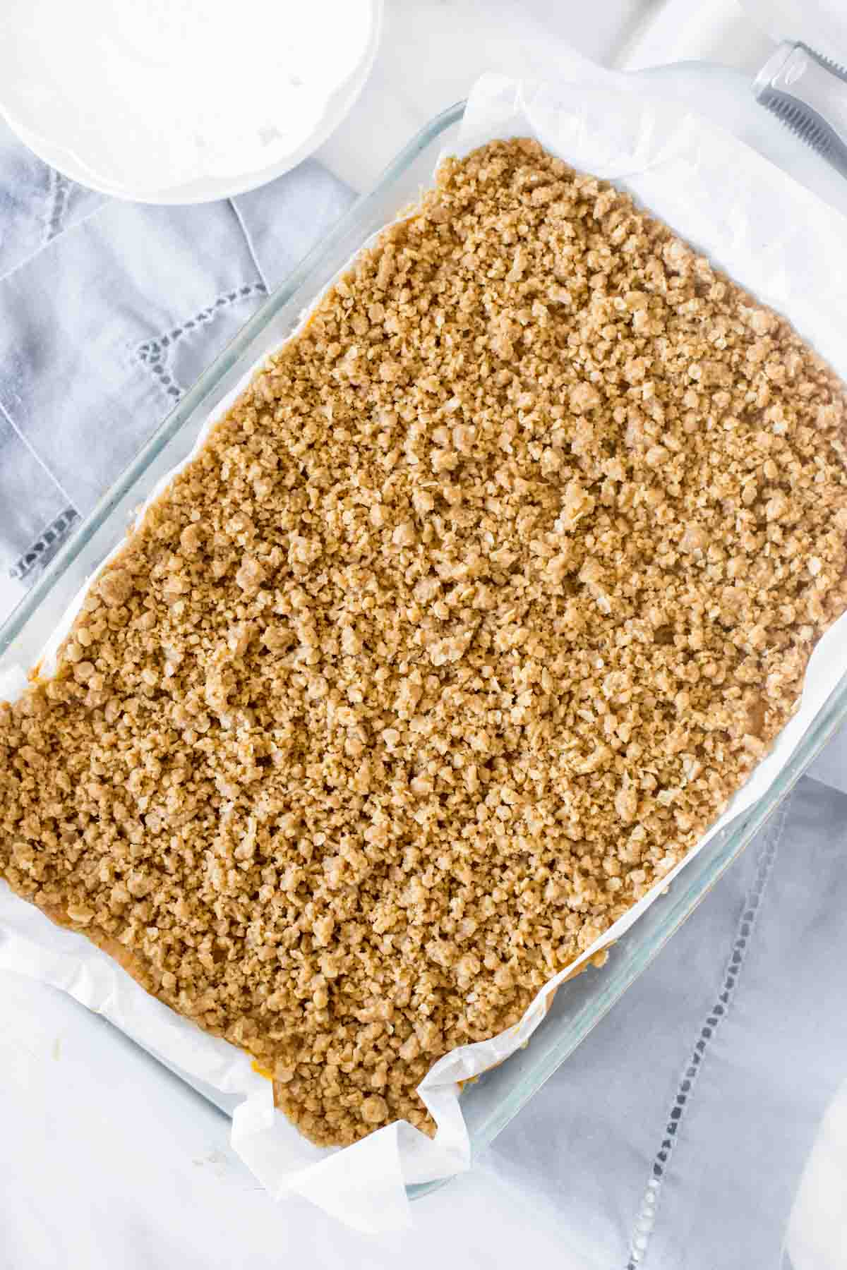 9x13 inch pan of pumpkin bars with streusel topping, from above.