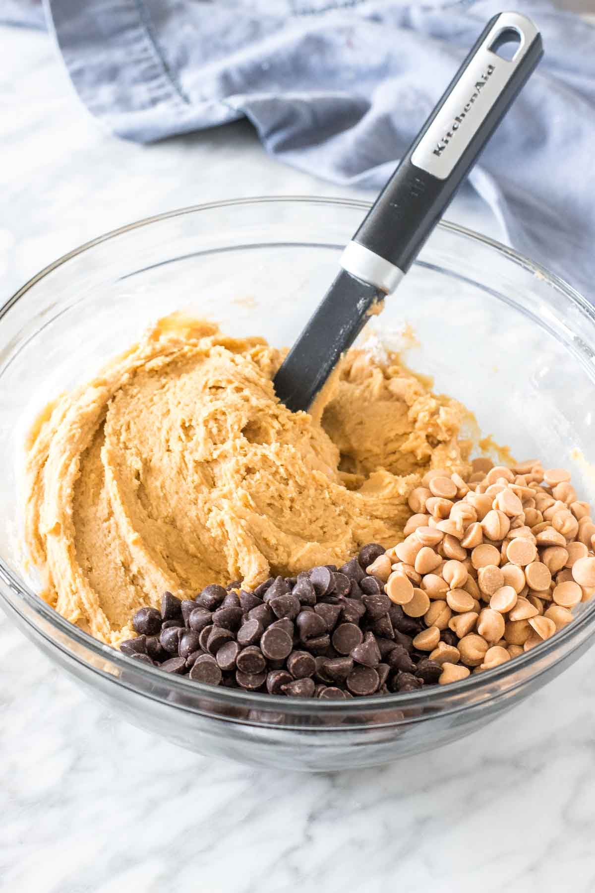 Bowl of cookie dough with chocolate chips and peanut butter chips.