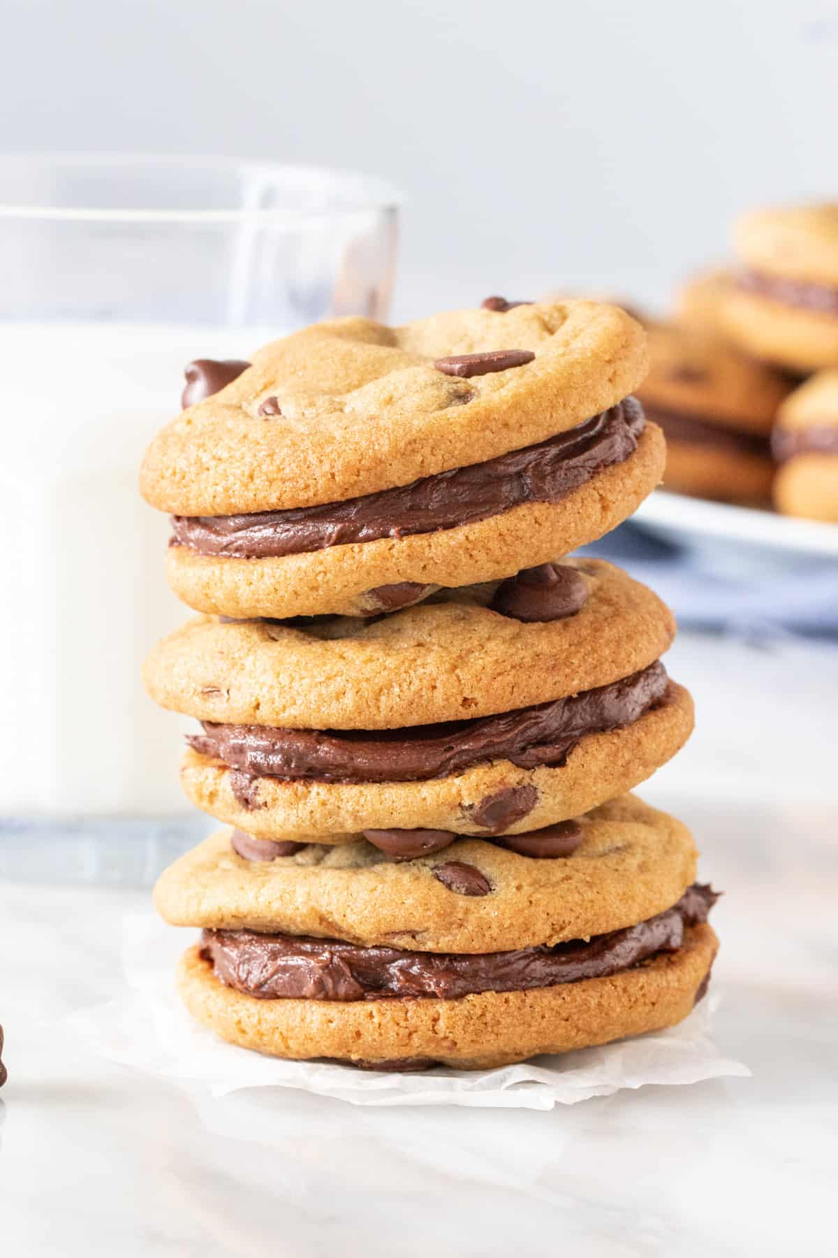 Stack of cookies with buttercream in the middle.