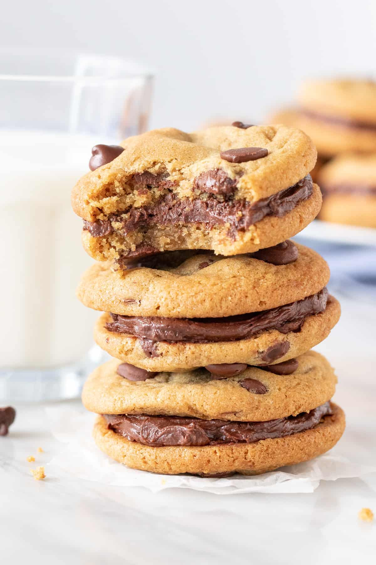 Stack of 3 sandwich cookies with chocolate frosting in the middle.