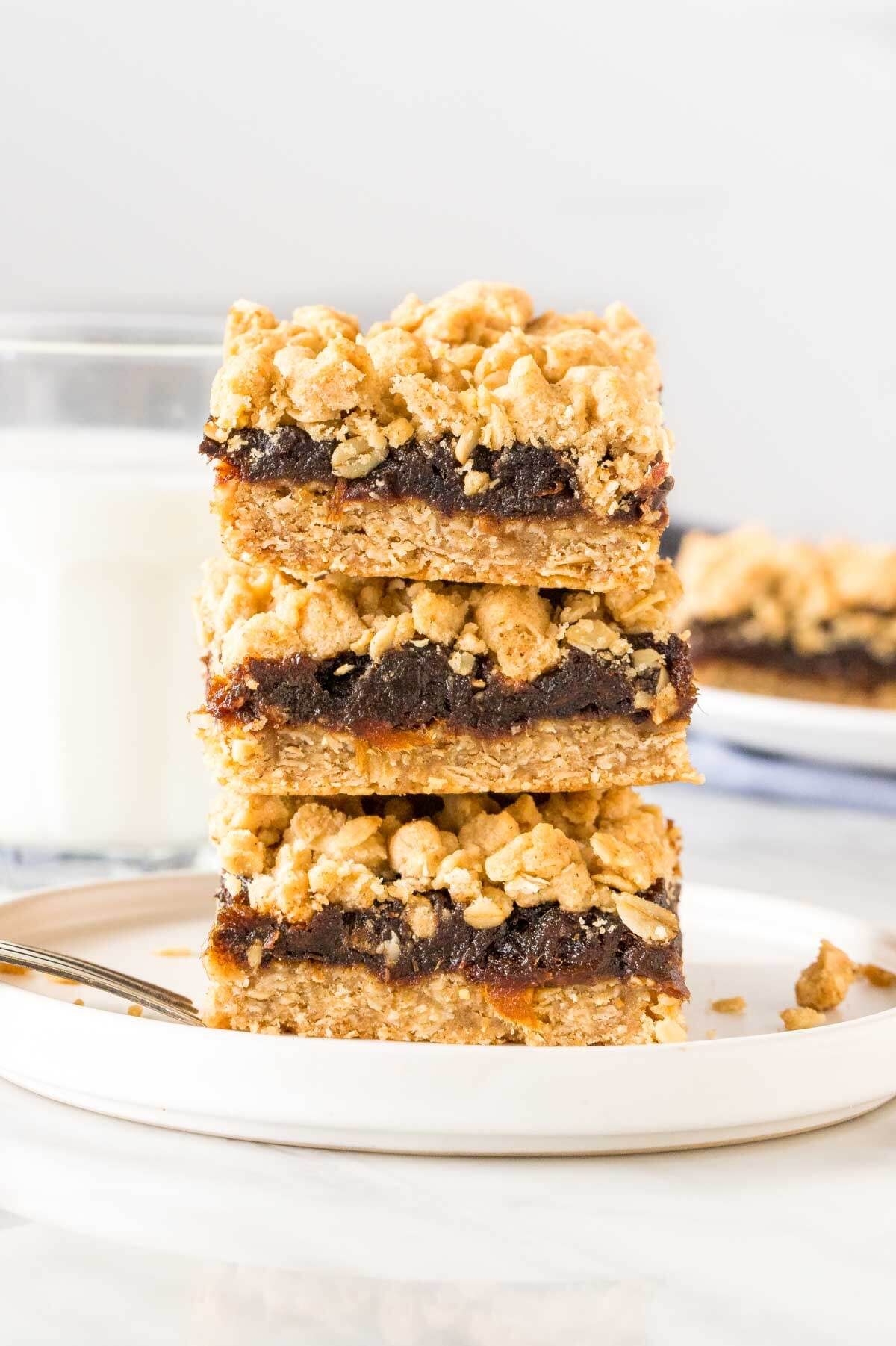 Stack of 3 date squares with oatmeal crumble topping.
