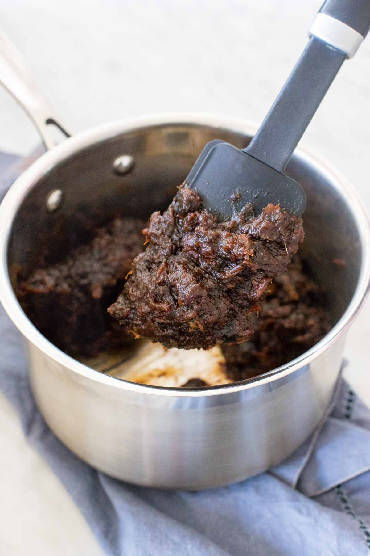 Boiled date mixture in a pan.