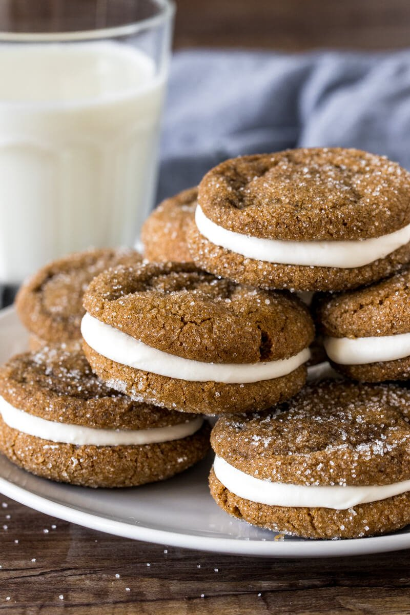 Plate of molasses sandwich cookies with marshmallow frosting.