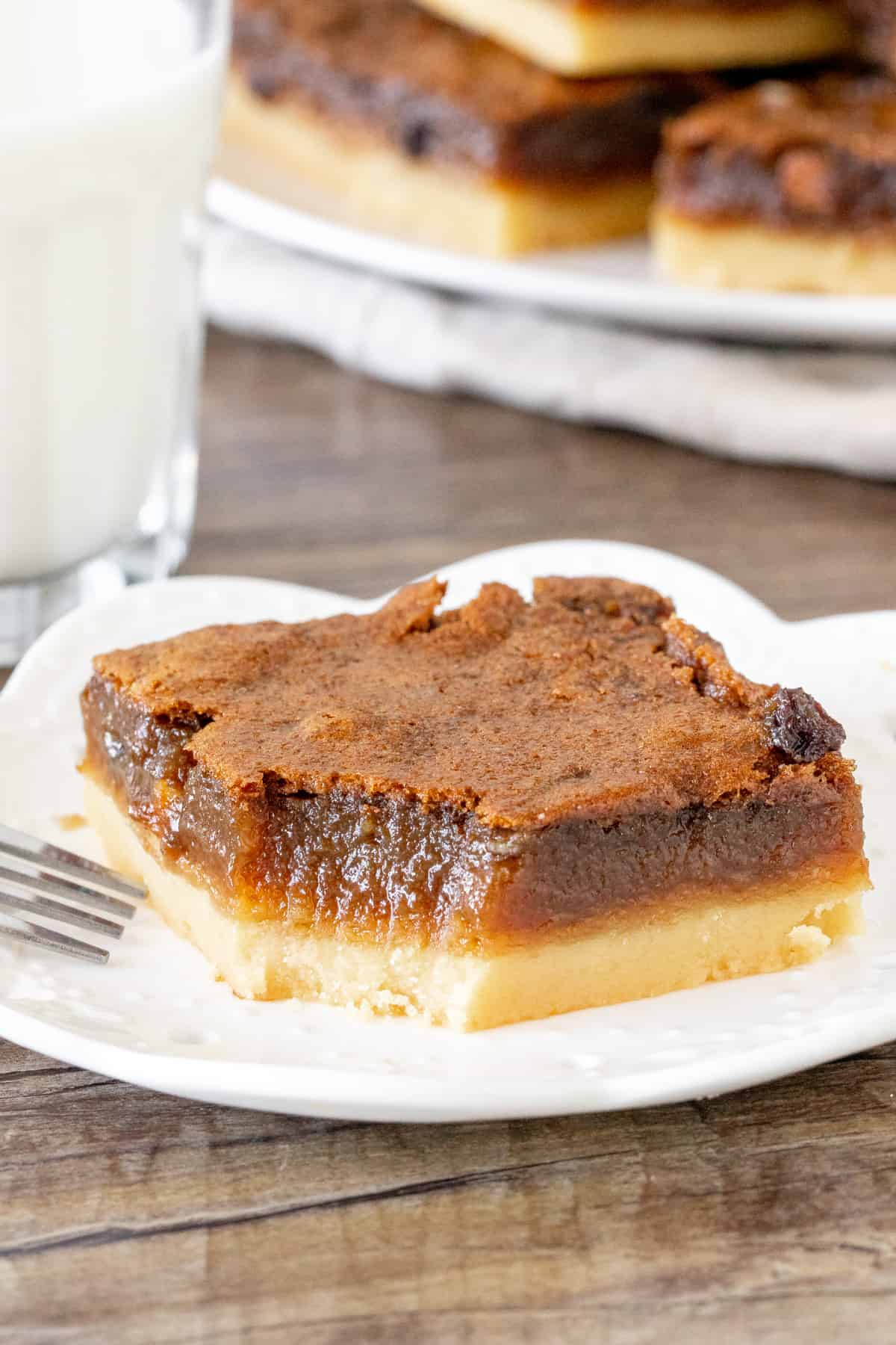 Shortbread bar with brown sugar layer on top with a bite taken out of it.