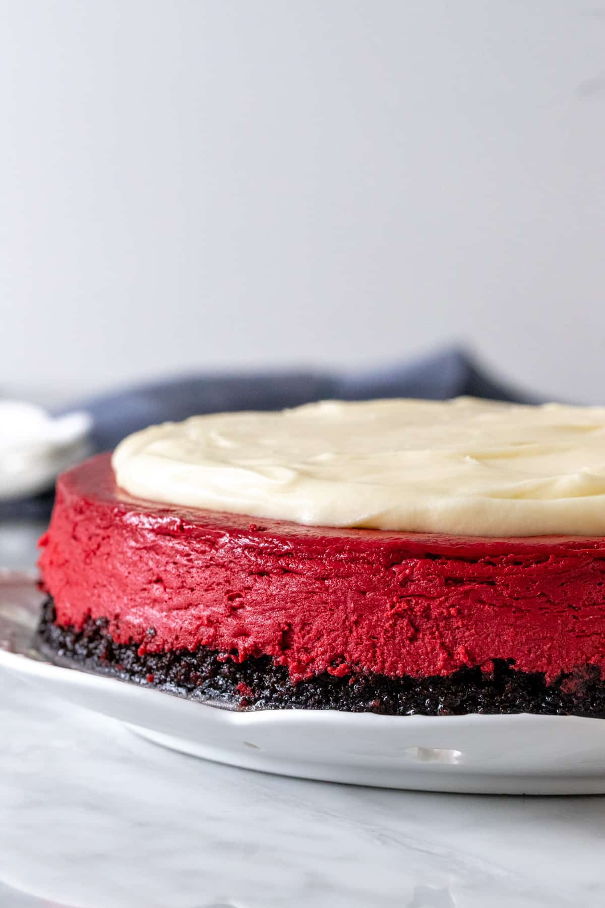 9-inch round cheesecake with cream cheese topping
