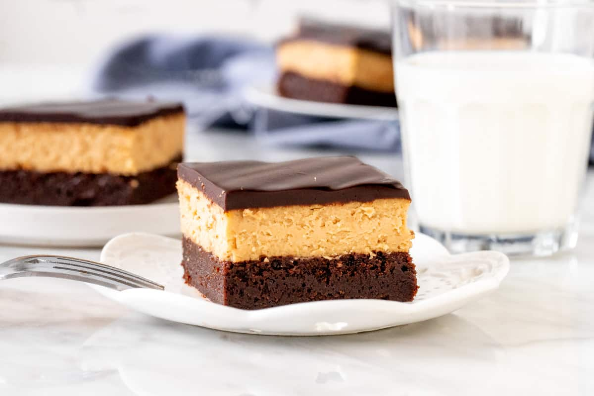Triple layer peanut butter brownie on a plate.