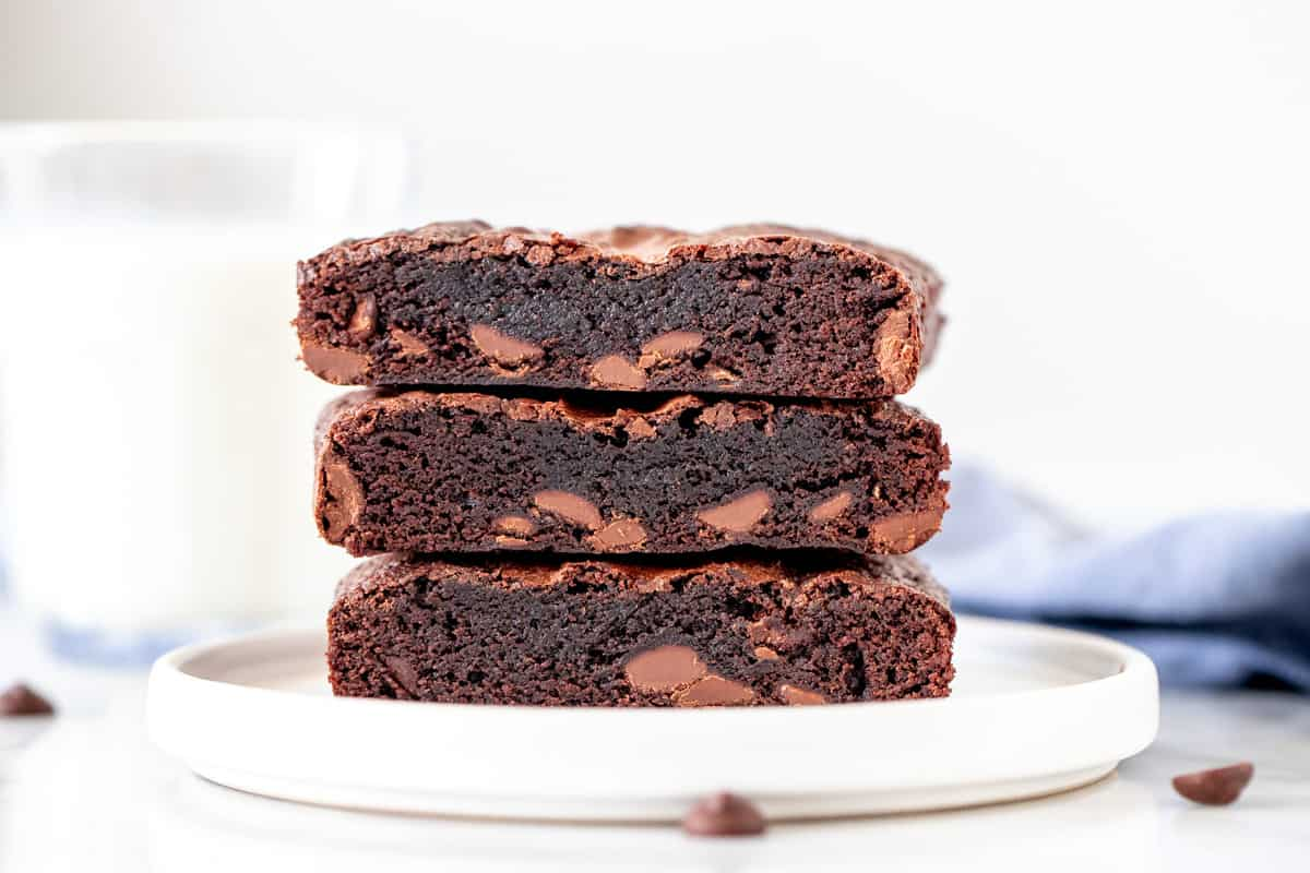 3 small-batch brownies stacked on a plate.