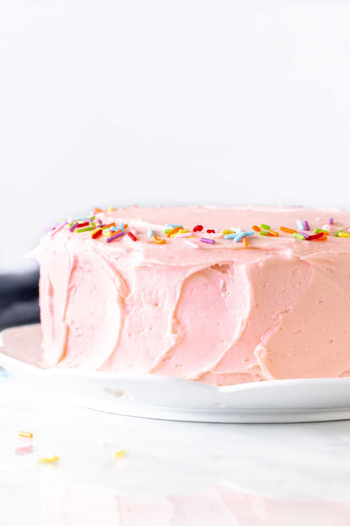 Layer cake with pink frosting.