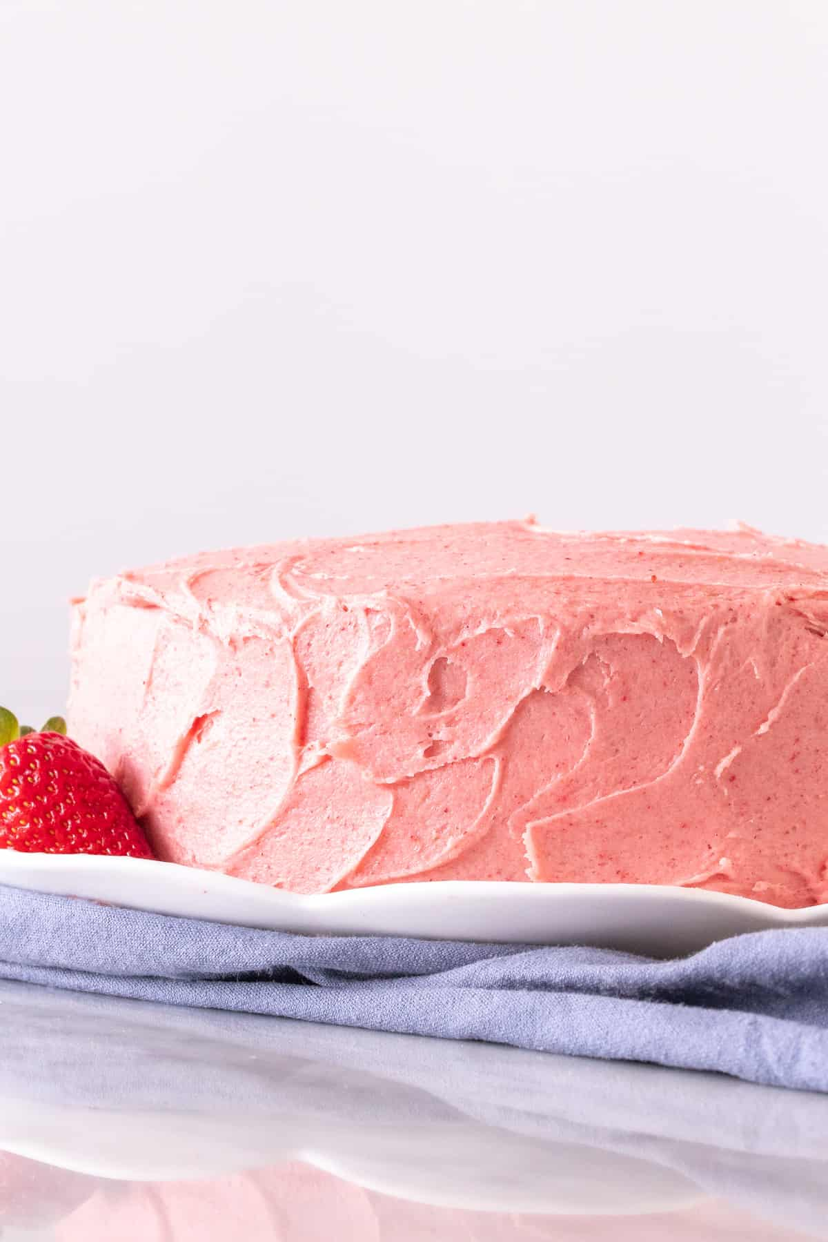 8-inch pink layer cake on a plate.