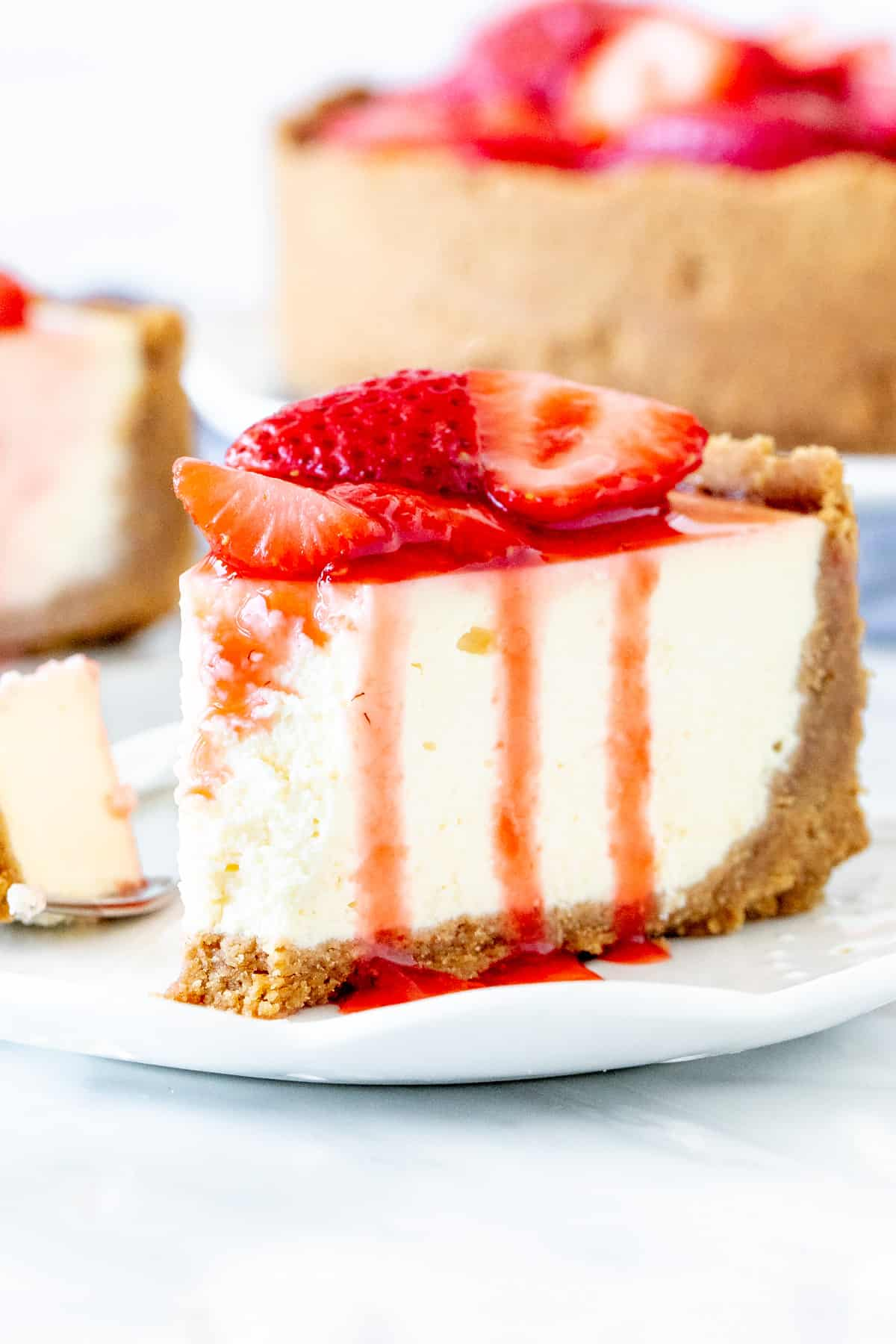 Slice of strawberry cheesecake on a plate