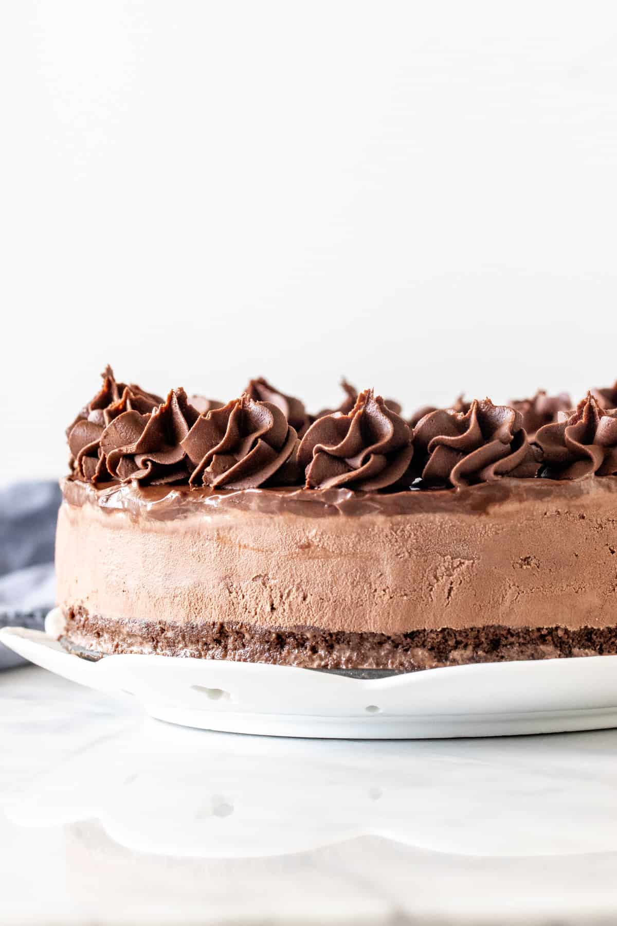 Chocolate ice cream cake with brownie base and chocolate frosting
