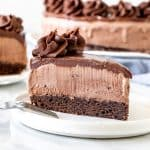 Slice of ice cream cake with brownie base.