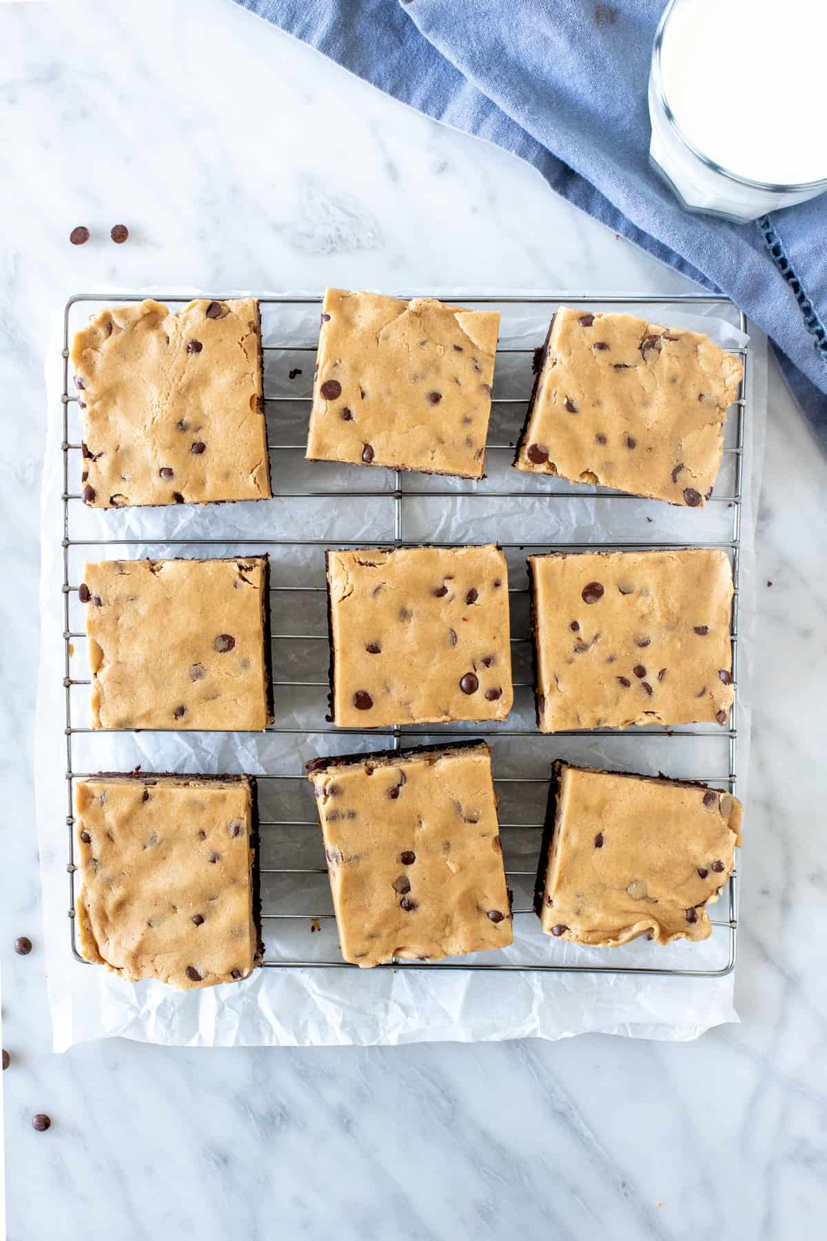 Cooling rack with 9 cookie dough topped brownies