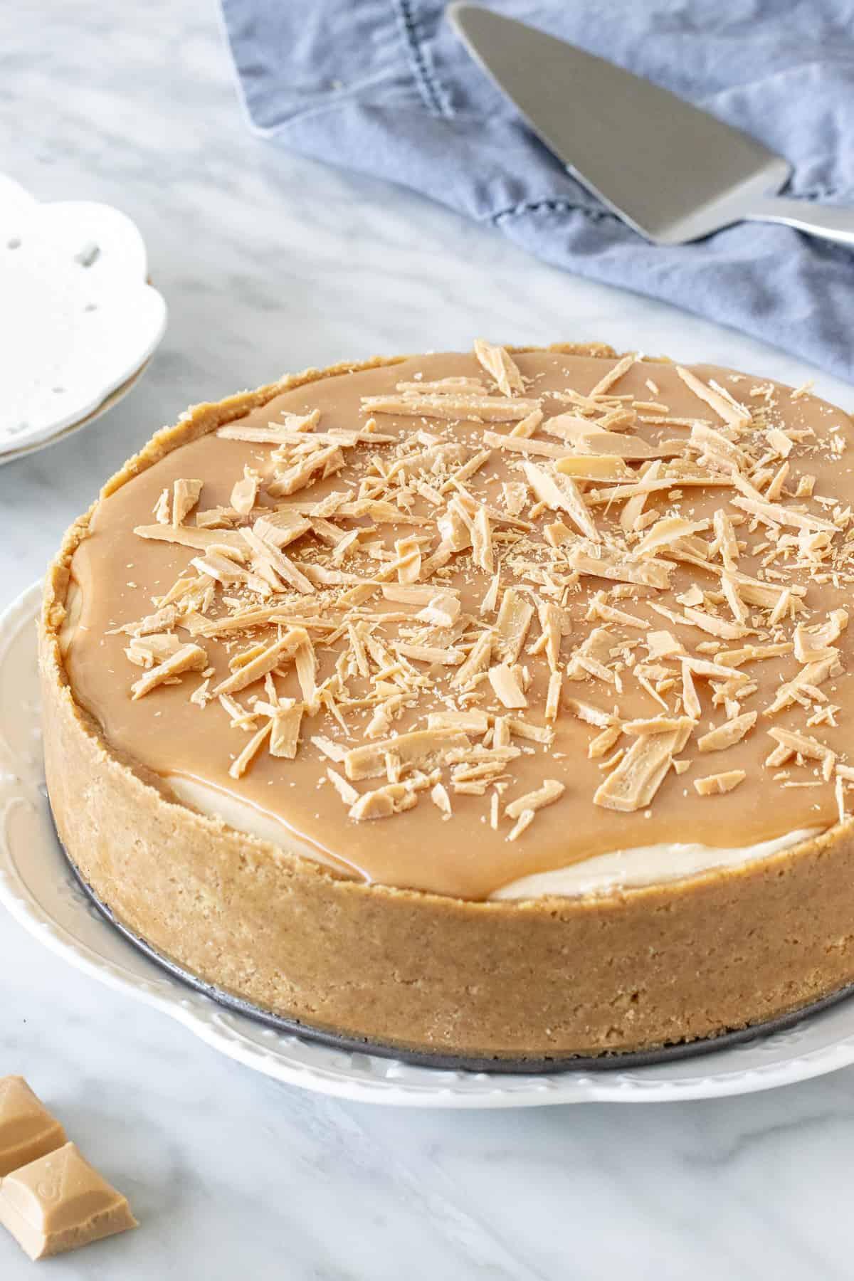 Caramilk cheesecake with biscuit crust and Caramilk topping.