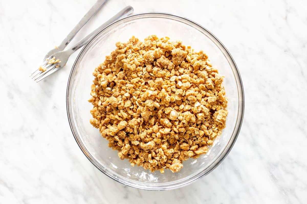 Bowl of oatmeal crumble mixture.