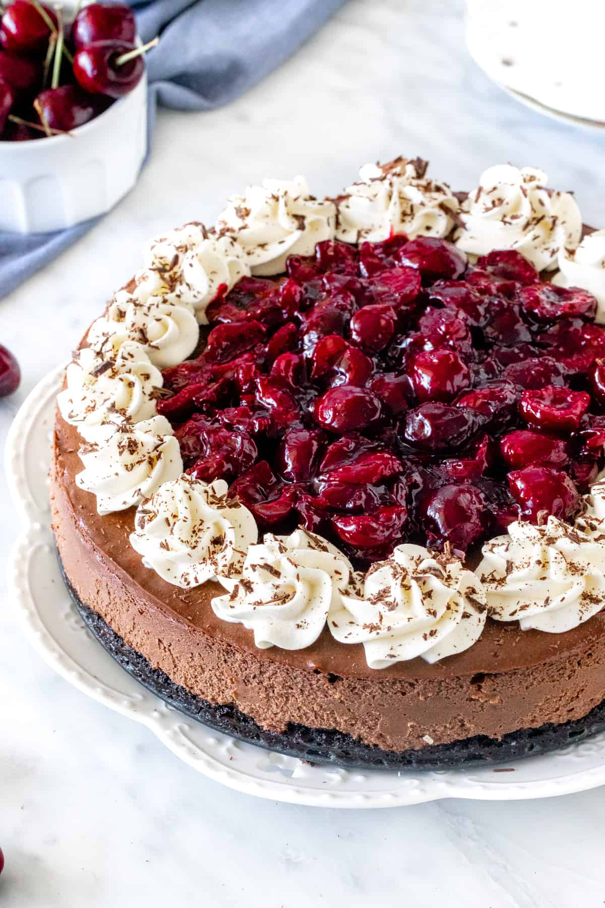 Black forest cheesecake on a plate.