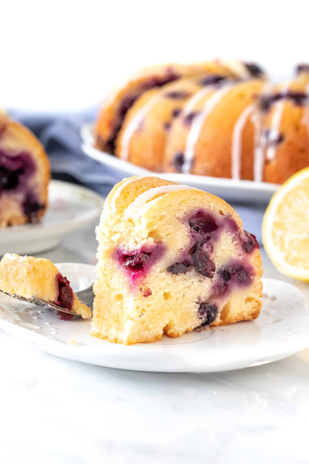 Slice of bundt cake dotted with berries.
