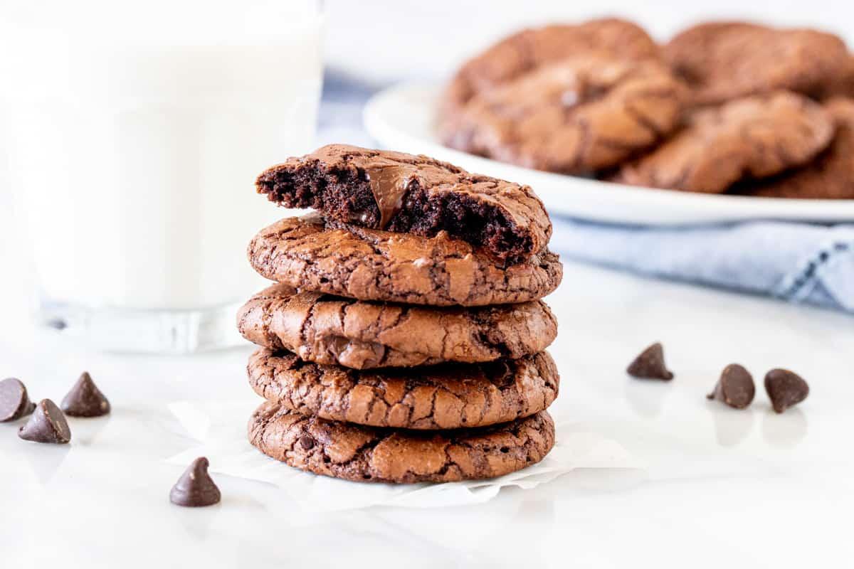 Stack of chocolate cookies with top cookie broken in half.