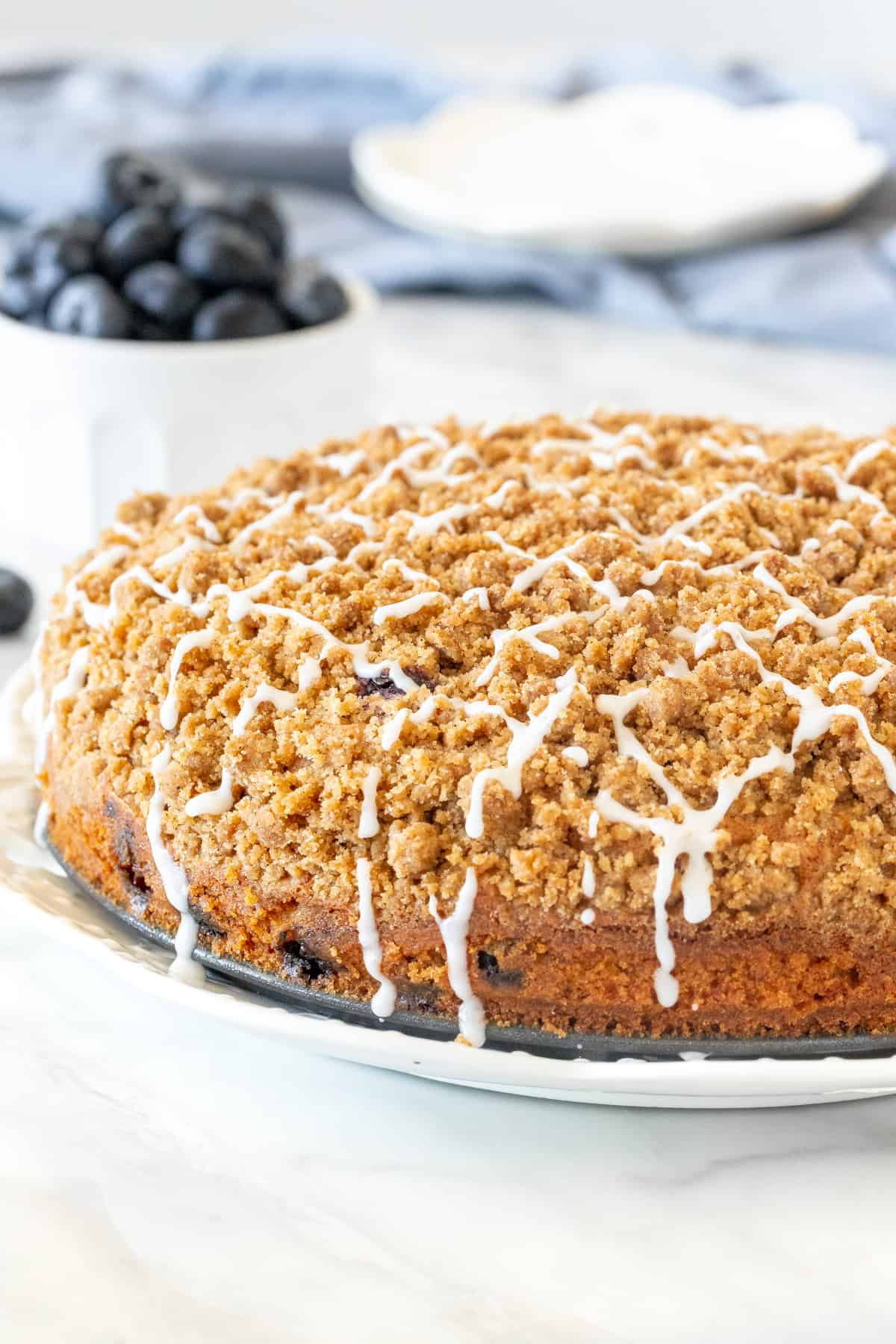 Blueberry coffee cake with streusel topping and a drizzle of glaze