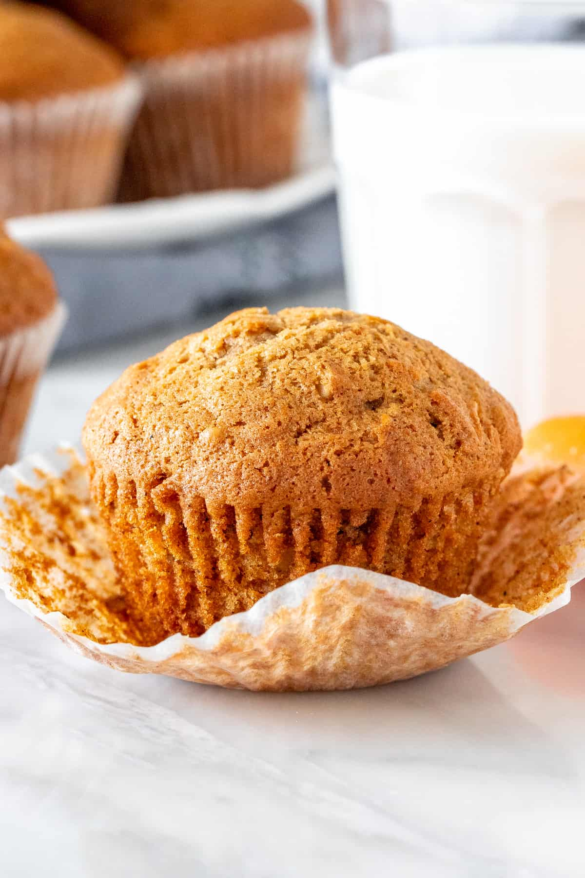 Carrot cake muffin with a glass of milk