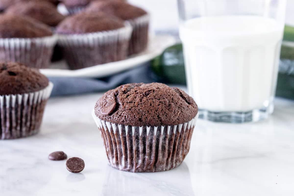 Zucchini chocolate muffin with a glass of milk