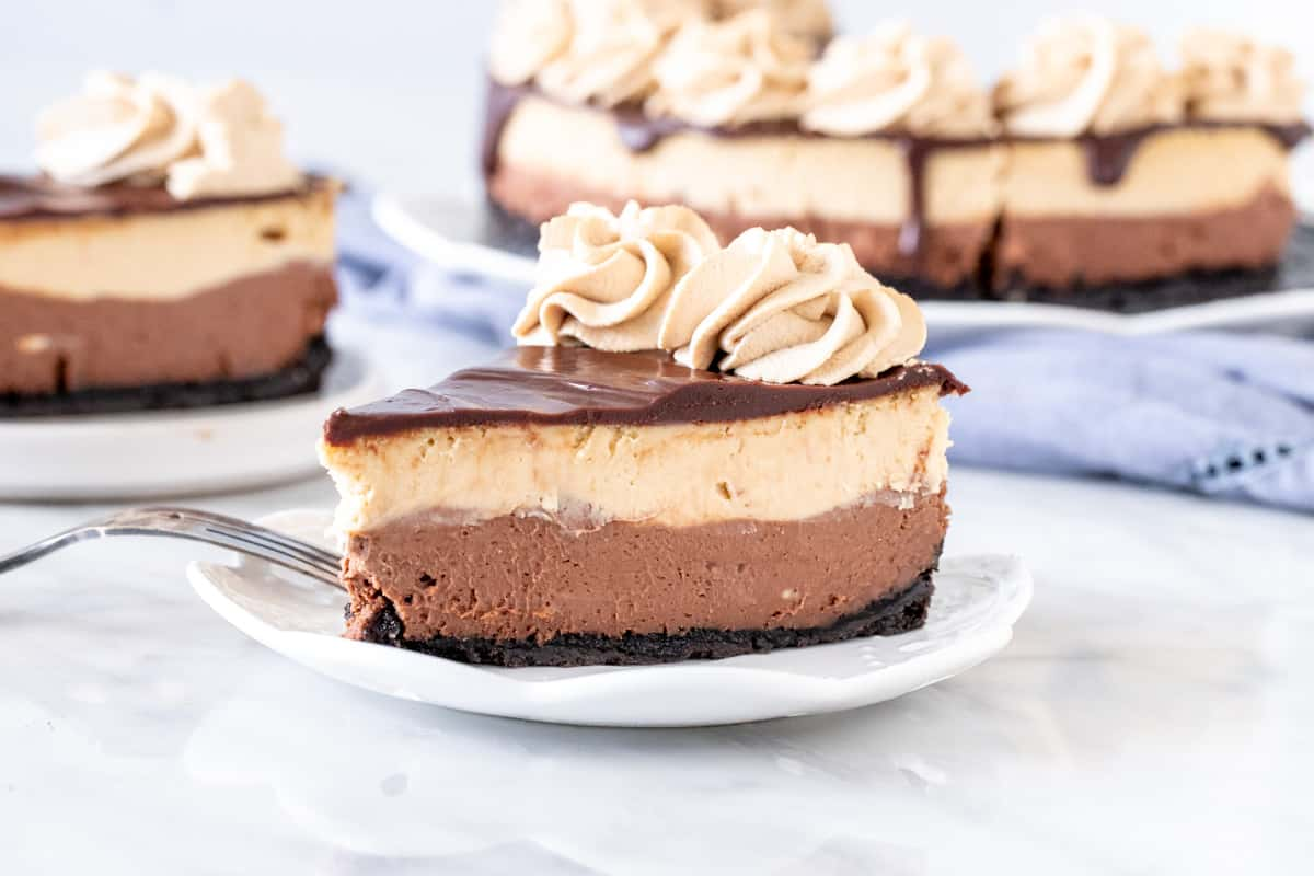 Slice of layered mocha cheesecake on a plate