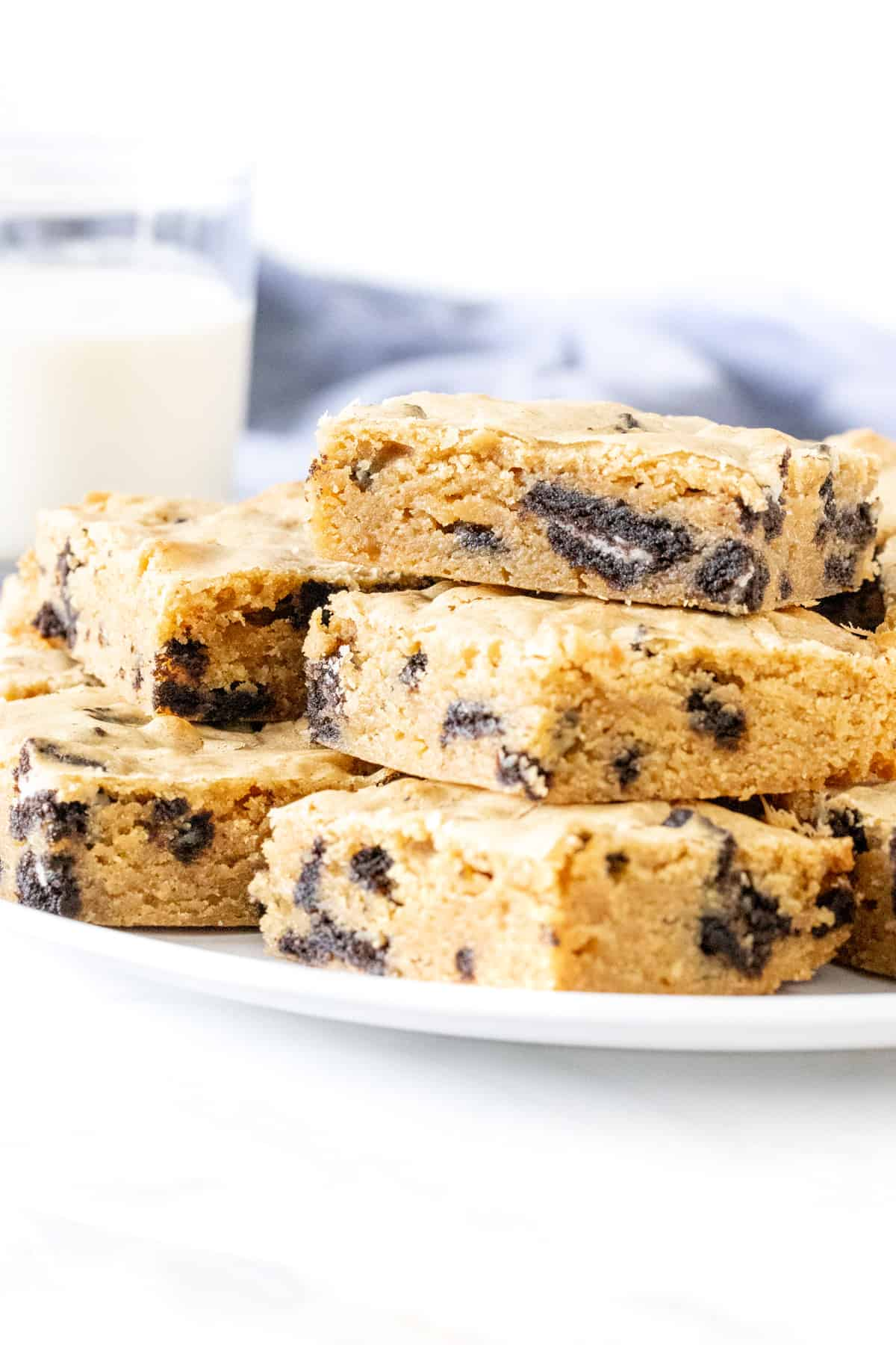 Plate of Oreo blondies stacked on top of each other.