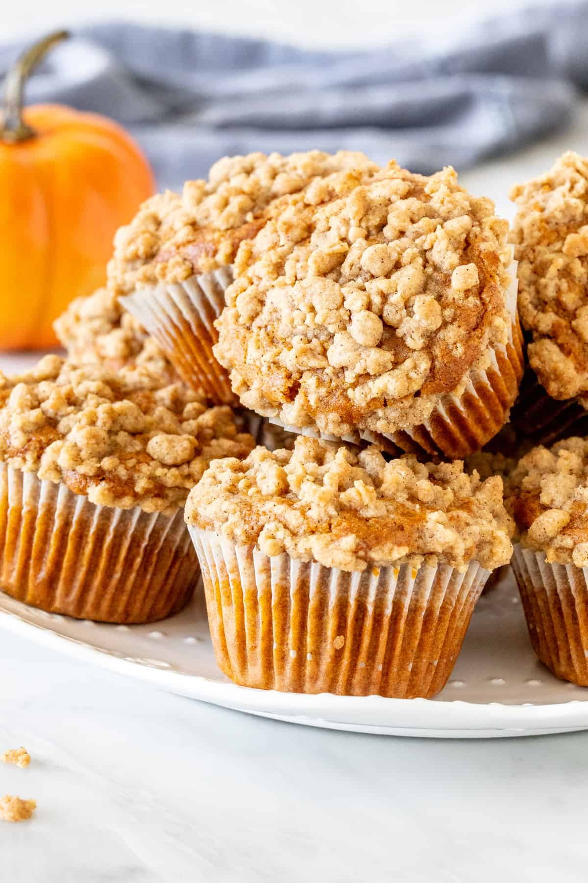 Plate of pumpkin muffins with streusel topping.