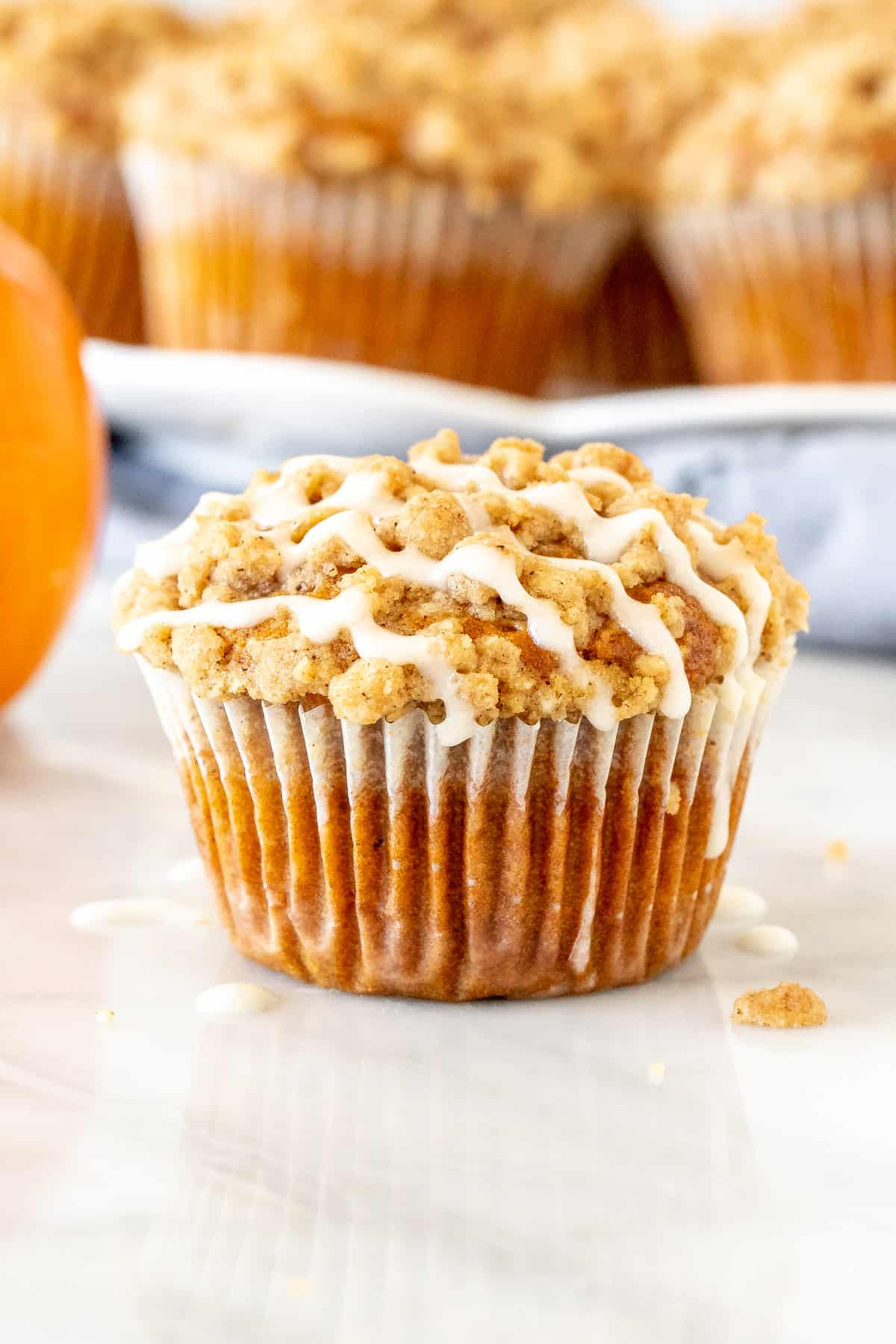 Pumpkin streusel muffin with a drizzle of glaze