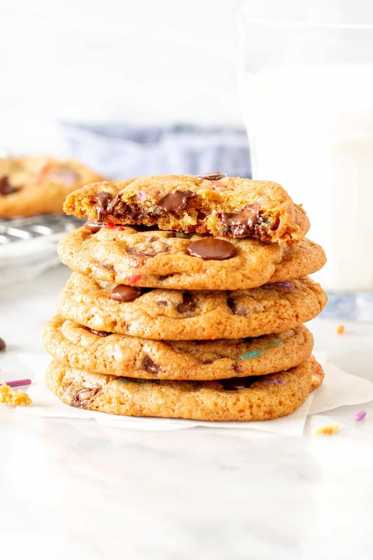 Stack of birthday chocolate chip cookies, with top cookie broken in half