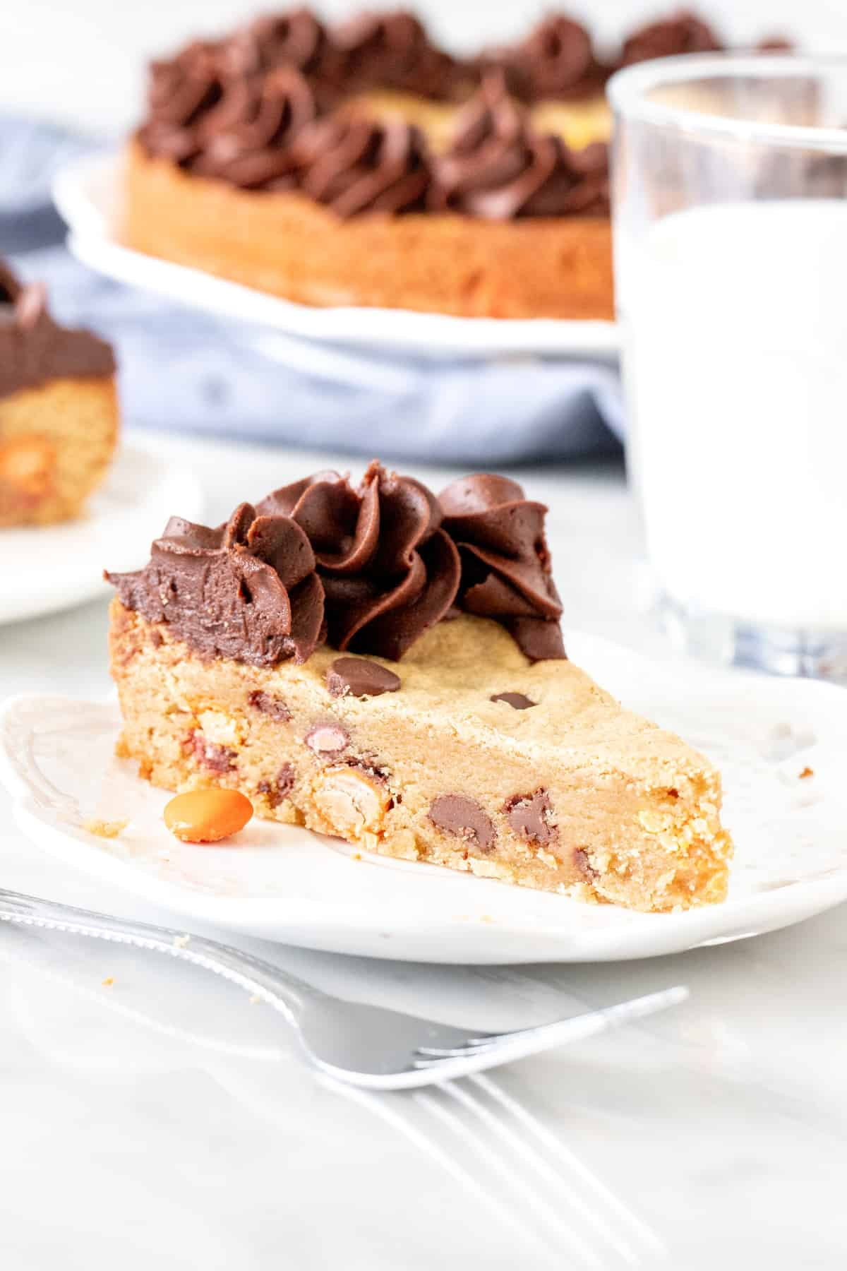 Slice of peanut butter cookie cake with peanut butter frosting