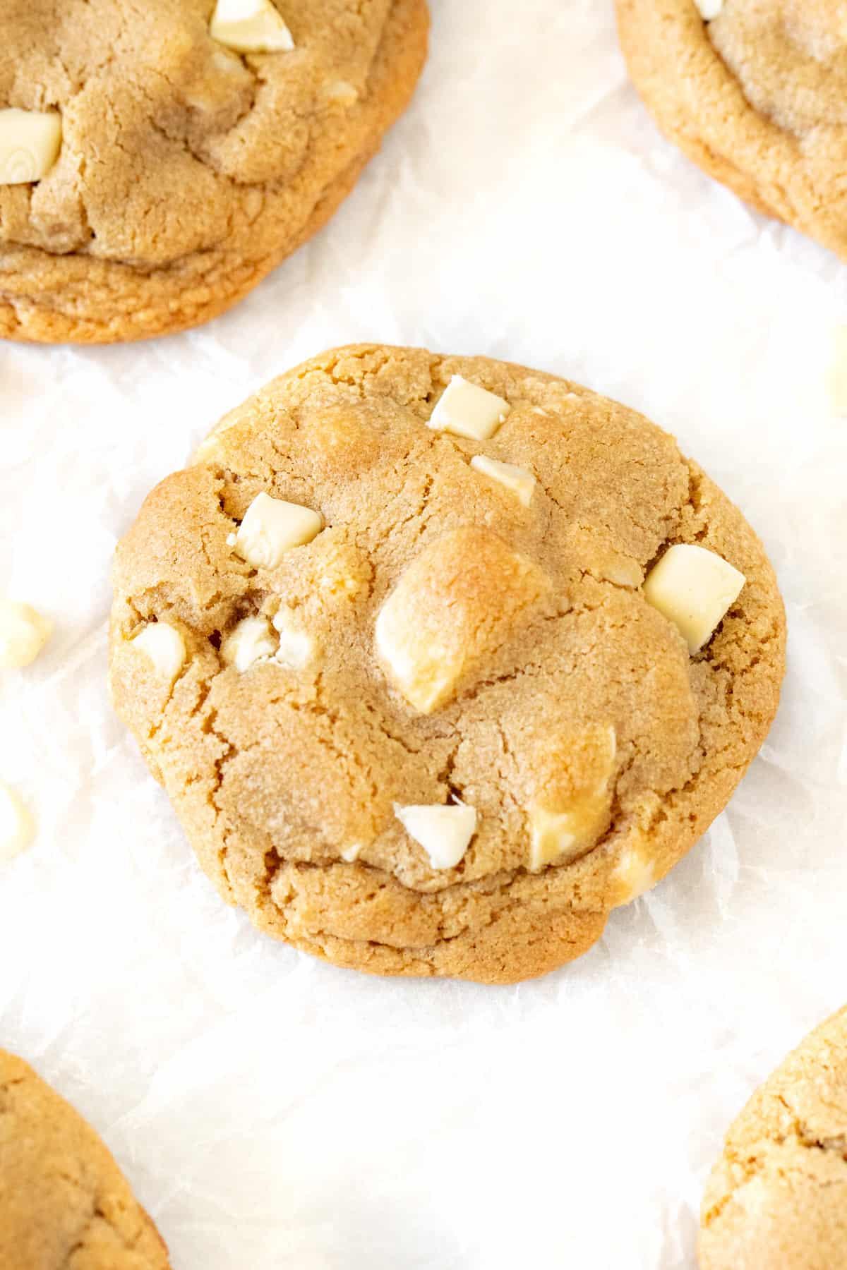 White chocolate chunk macadamia cookies on baking paper
