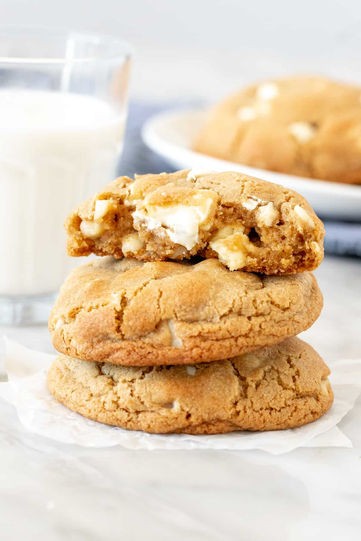 3 white chocolate chunk cookies, stacked on top of each other